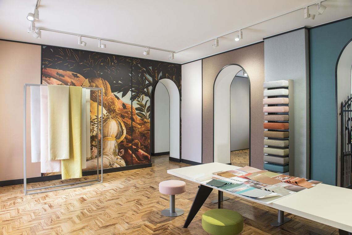 An artwork has been printed on vinyl for one wall of this Vescom showroom in Milan