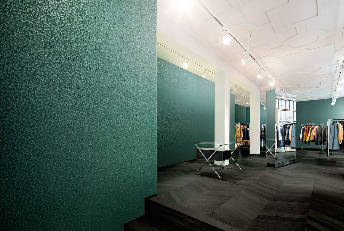 Wallcovering design Aikin adds a warm finish to high-end retail spaces, and stands up to heavy-duty use
