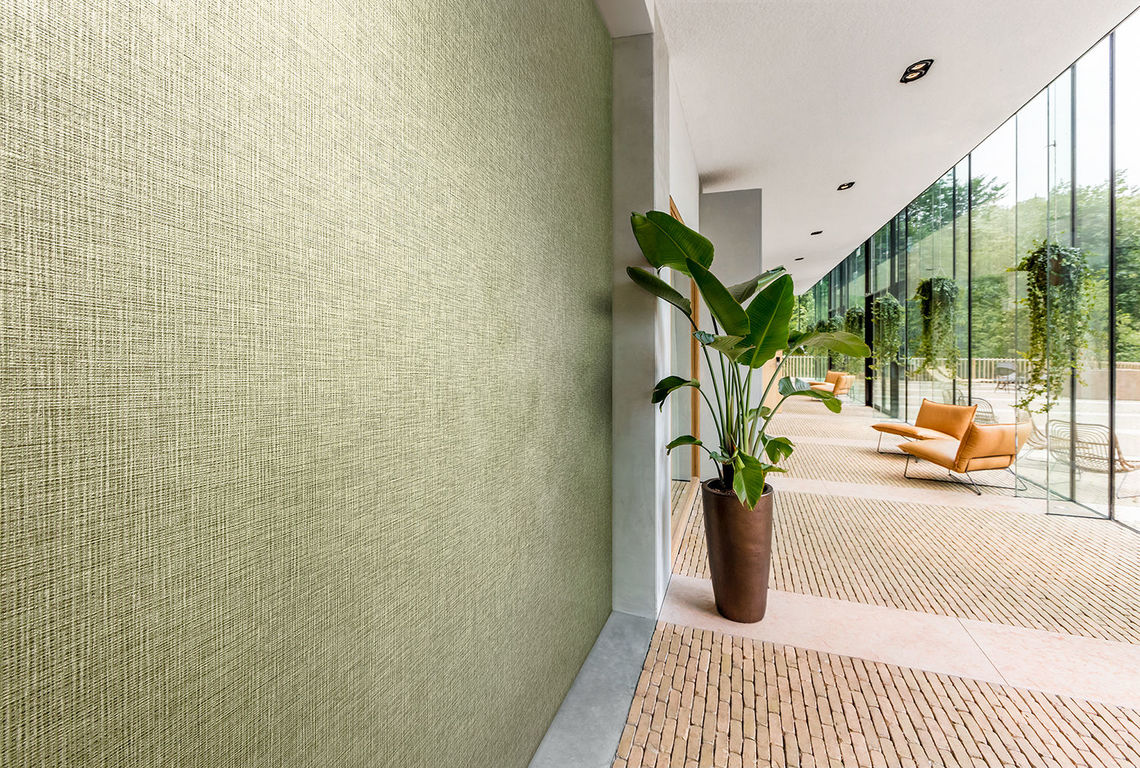 Vinyl wallcovering design Greenbo features soft, organic forms inspired by nature