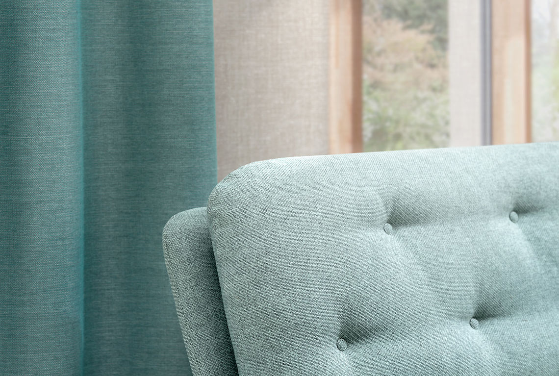 Upholstery fabric Noss applied on a sofa