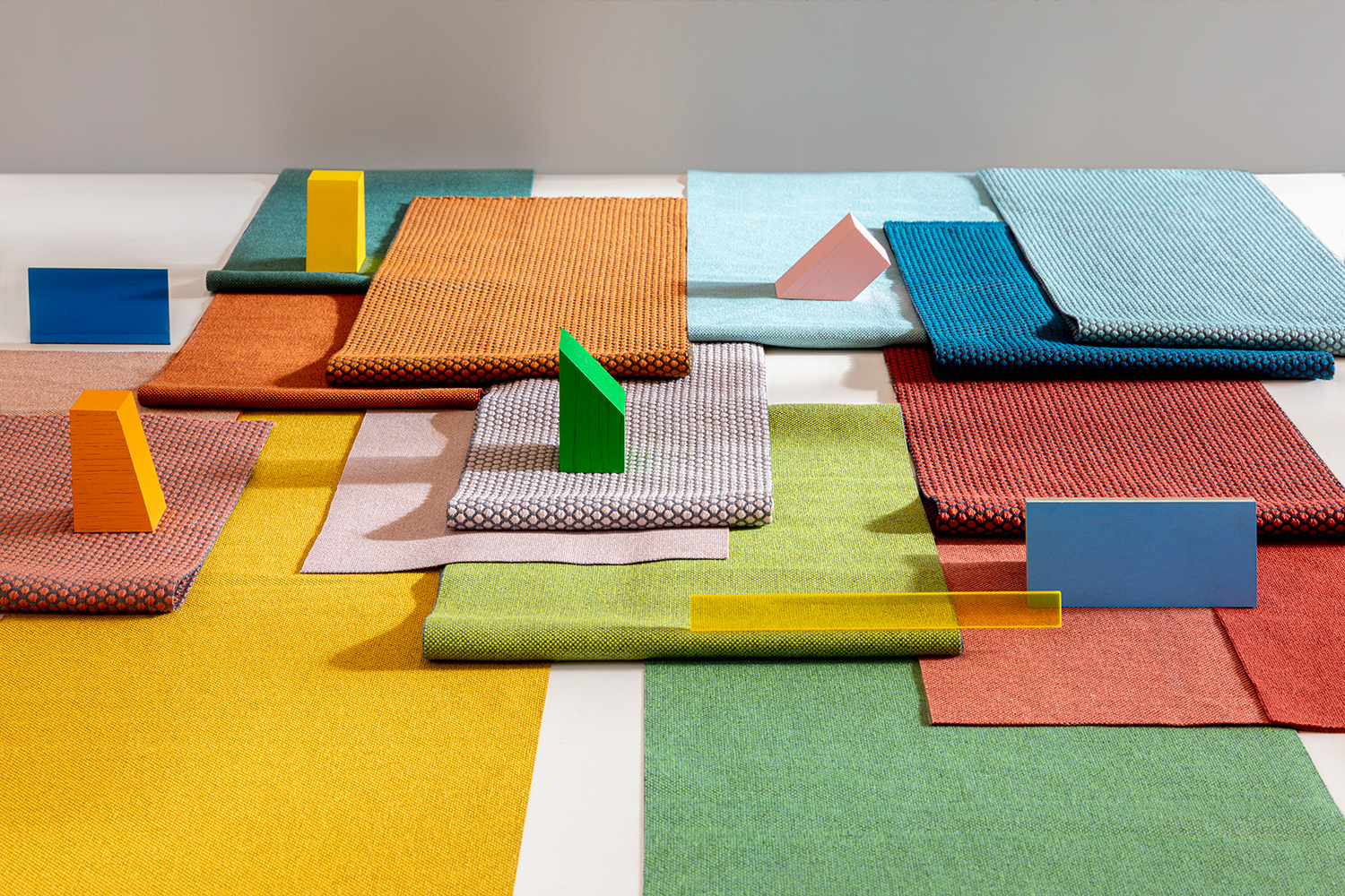 collage of various colours upholstery fabrics Acton & Rolla