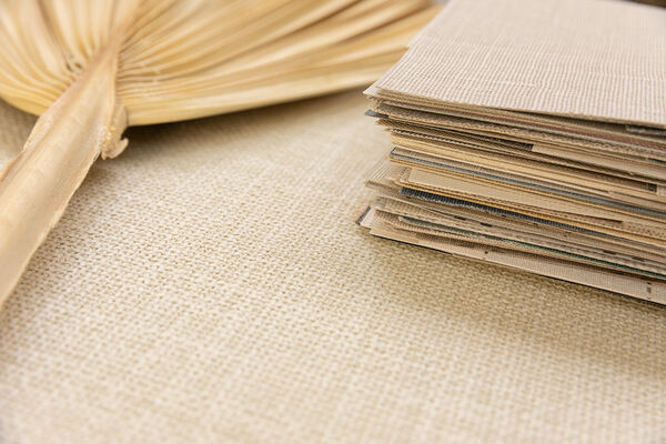 stack of textile wallcovering designs