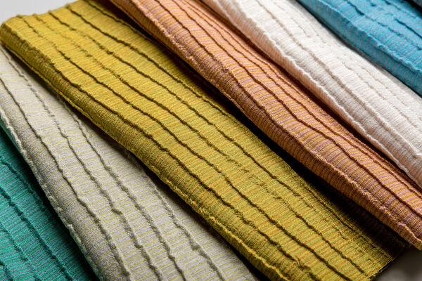 Close up van kleurenserie gordijnstof Naltar