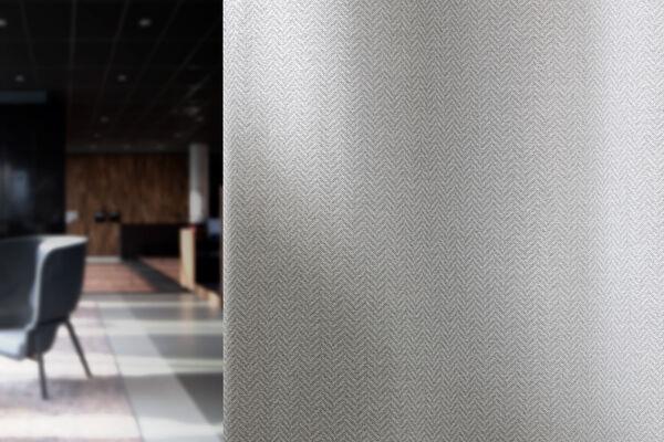 Dim out curtain with a herringbone design