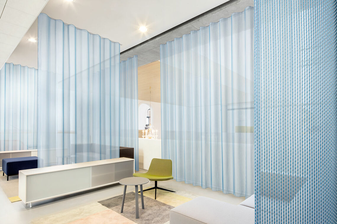 Acoustic curtain connects and divides an interior