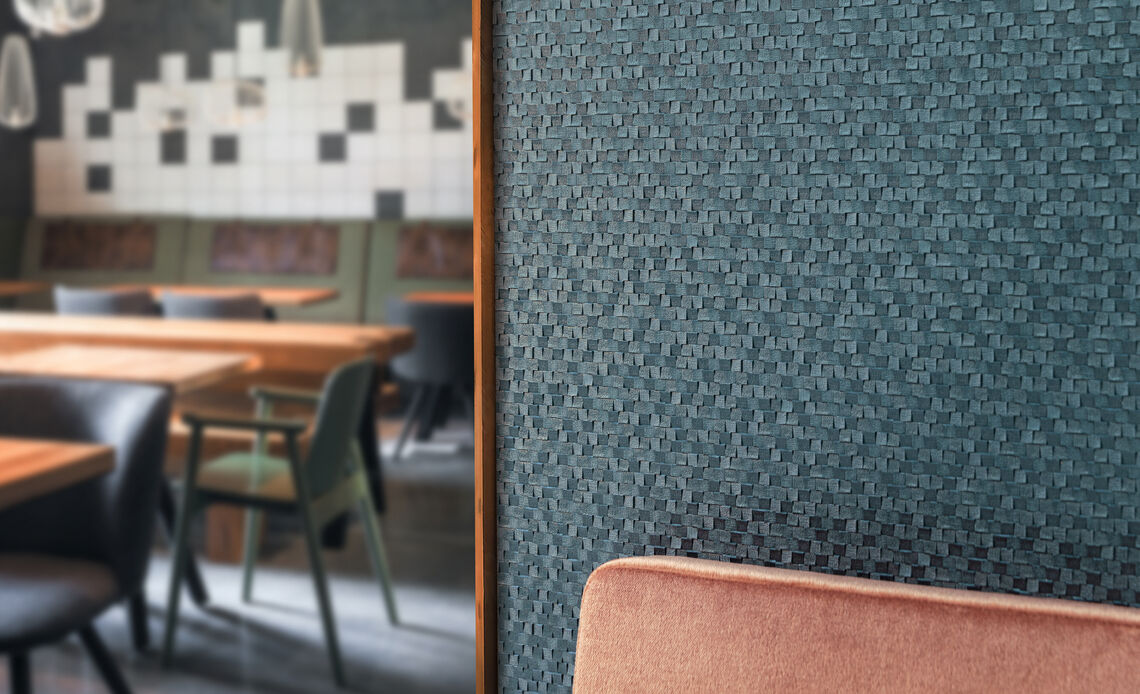 Blue wallcovering with a heavy embossment and radical structure