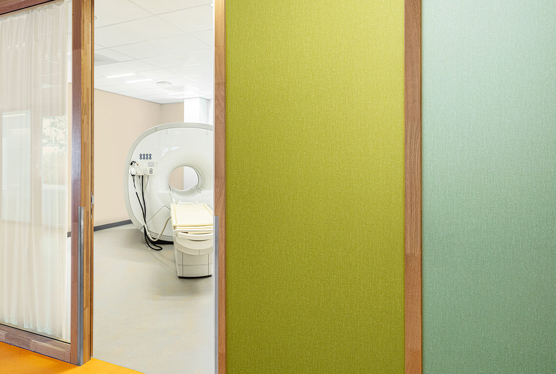 green wallcovering outside an OK hospital room