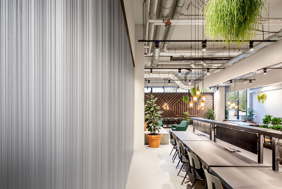 grey vertical striped wallcovering in office setting
