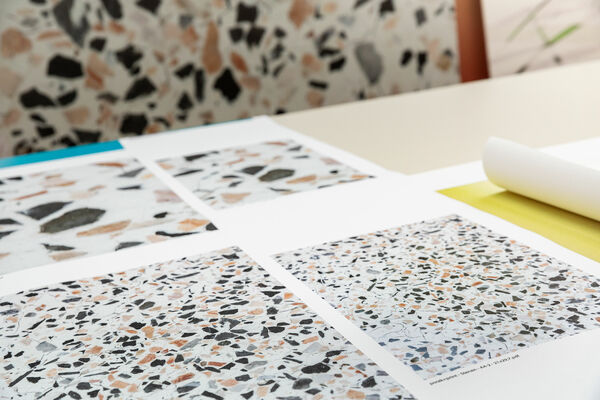 customized digital printed wallcovering samples spread out over a table