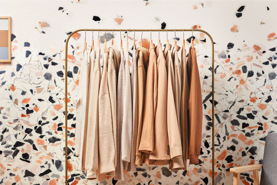 customized wallcovering behind a clothing rack in a retail store