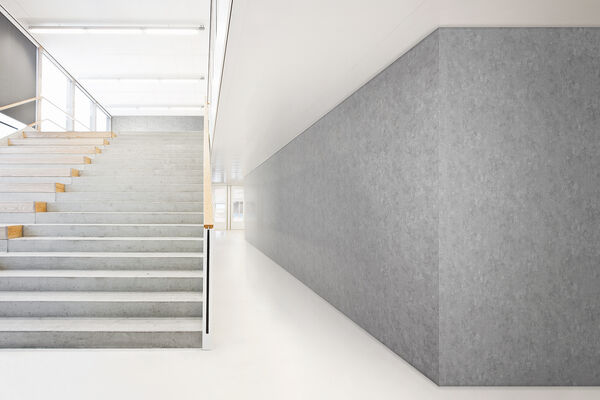 gray vinyl wallcovering applied on a wall next to staircase