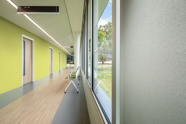 green and gray vinyl wallcovering in a hospital